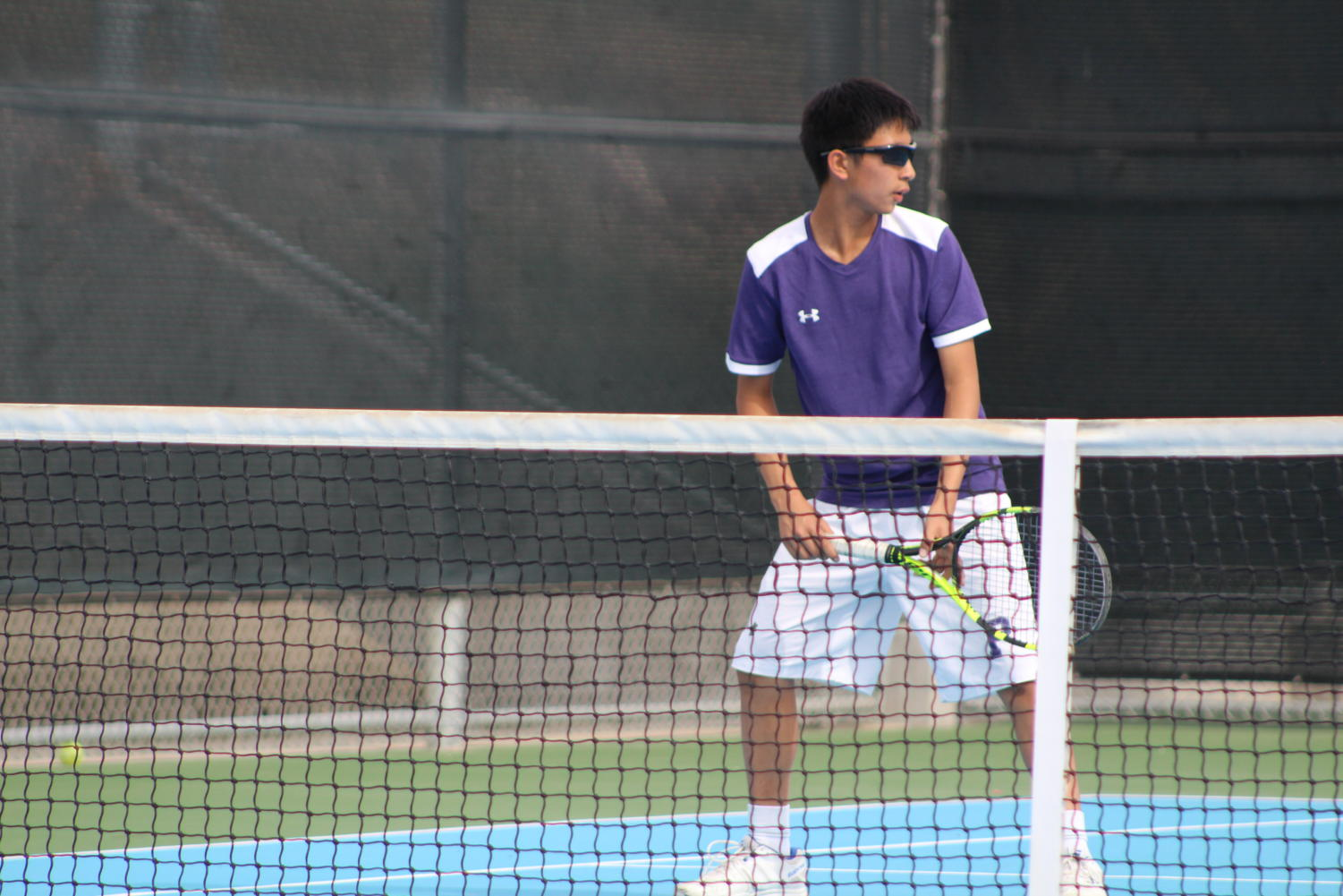 Hung anticipates for his doubles partner, co-captain and sophomore Taira Asakura, to serve the ball over to their opponents so the two pairs can begin a volley.