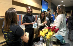 [From left to right] Samantha Gardner, Desmond Stevens, Emily Sheridan and Megan Kirby are in the lobby of the theater greeting parents who watched the show and congratulating the student cast on May 3 while enjoying the company of each other.
