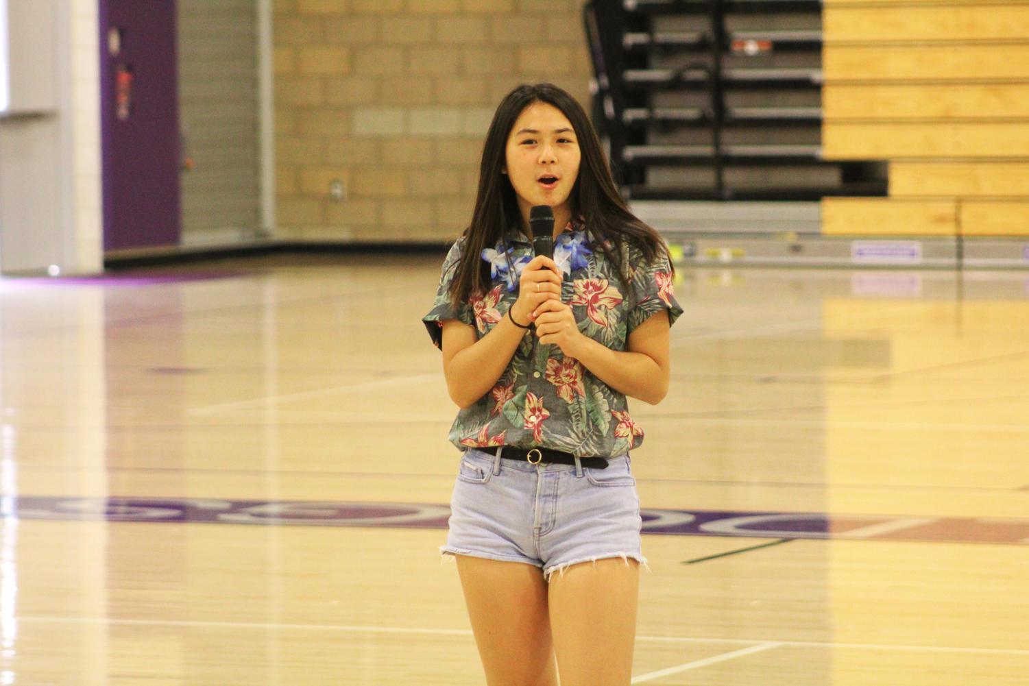 Spirit and rally commissioner and future vice president Lauren Hwang leads the crowd in a cheer to kick off the rally.