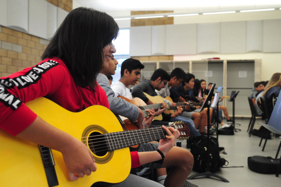 Freshman+Sherise+Marron+in+Guitar+1+strives+for+excellence+even+nearing+the+end+of+the+year.+