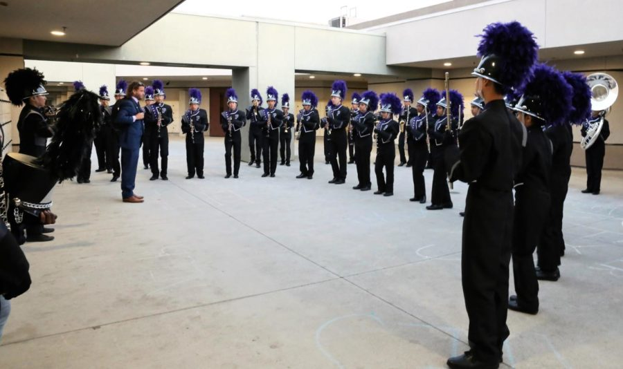 The+marching+band+gets+their+final+words+of+encouragement+from+teacher+Desmond+Stevens+before+embarking+on+their+field+show+at+the+Tesoro+Marching+Band+Field+Tournament%0A