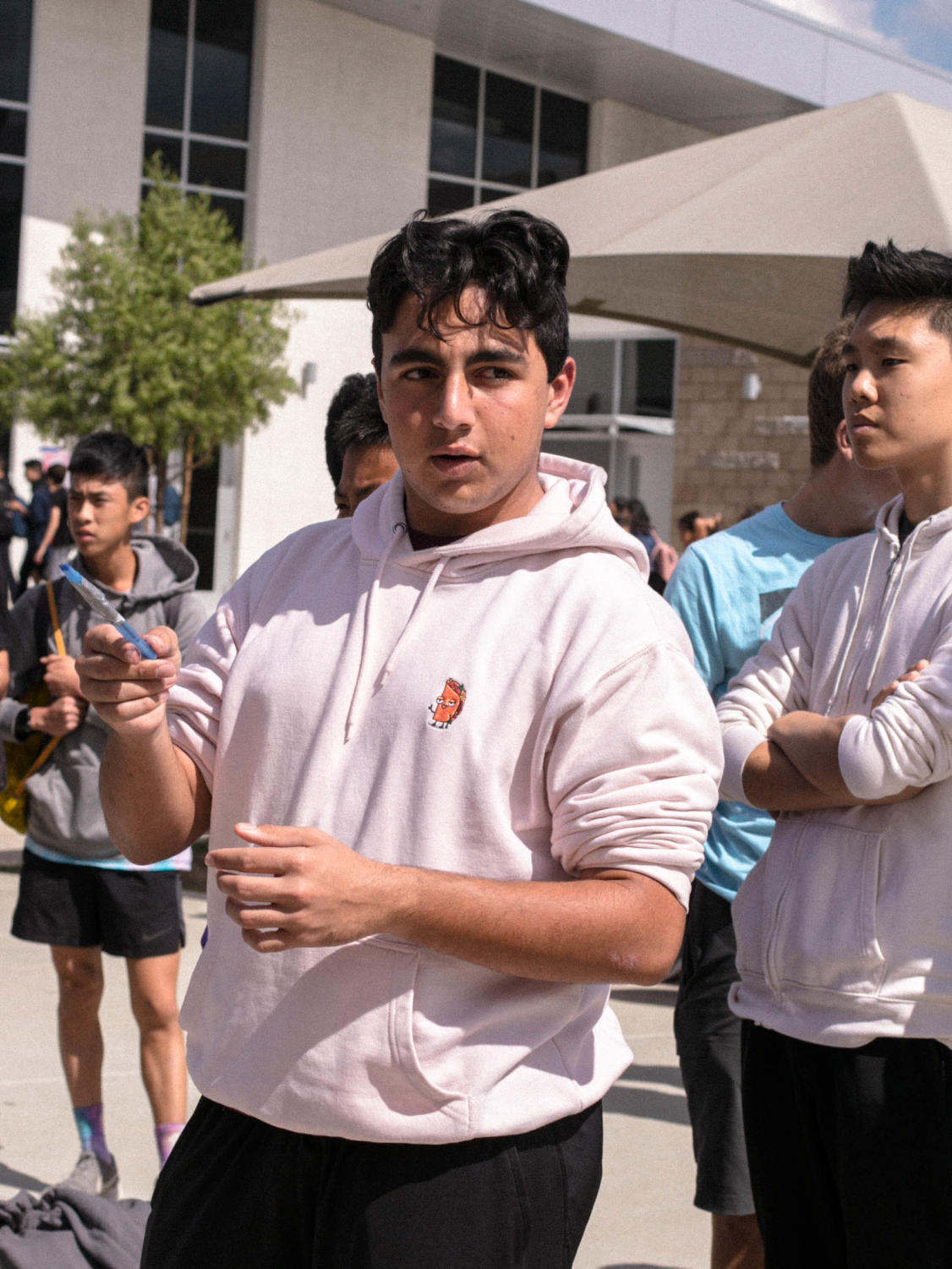 """Junior Elias Tchapadarian tries to win a free Forthcoming ticket at the """"Out of This World"""" balloon popping game. As an attempt to gain more student interest, ASB advertised a free Forthcoming ticket to one participant as an incentive, with junior Leonardo Pena winning the free ticket."""