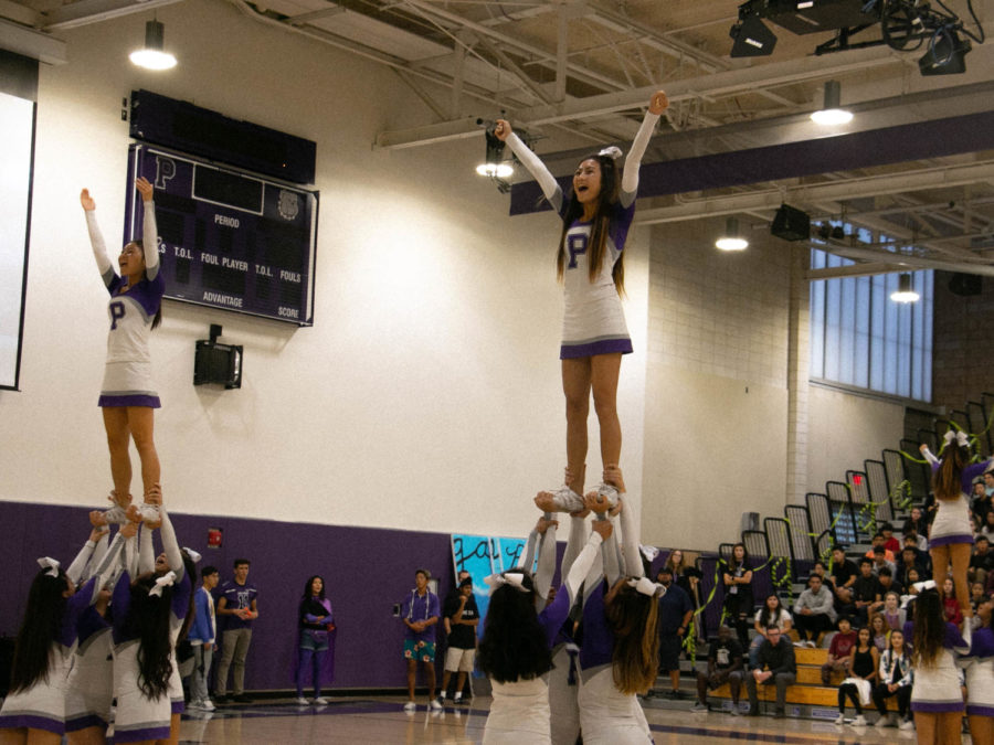 "Junior Jessalyn Nguyen chants ""victory!"" while in her stunt. Nguyen is one of the team's many fliers, and has been a flier for three years"
