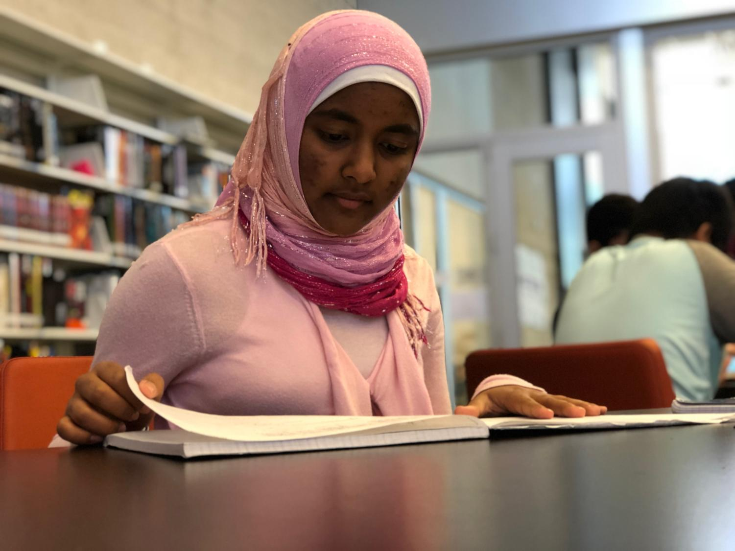 Sabreen studies for her AP Physics 1 class in the Student Union, working hard to maintain her demanding workload. In her free time, she also manages a Scratch program intended for third and sixth graders at Ardent Academy.