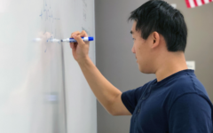 Junior Joyee Chen uses the whiteboard to tackle tricky problems by visually interpreting the question.