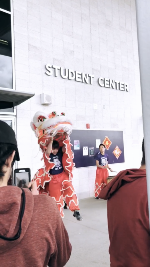 Chinese 3 students perform a vivid, southern-style traditional lion dance to represent prosperity and harbor good luck for the new year.