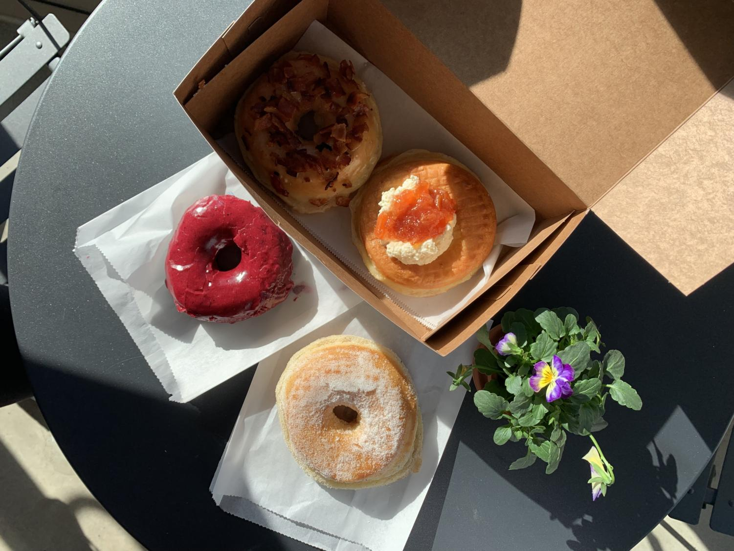 Oliboli offers a range of flavors atypical of most doughnut stores,  such as (going clockwise) Bumbleberry, Burnt Butter Bourbon Bacon, Fry Bread with Meyer Lemon and Guava Jam and Lavender Sugar.