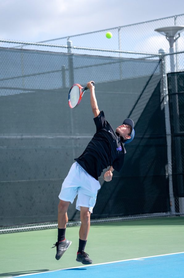 Freshman+AJ+Moore+leaps+into+the+air+during+his+serve+against+Irvine+High%E2%80%99s+first+ranked+player.+Moore+won+the+match+6-3+and+placed+third+individually+at+the+Pacific+Coast+League+Finals+on+April+24.+