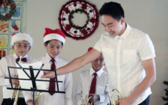 Junior Roy Bae proceeds to play the piece at the Christmas concert with three of his mentees to demonstrate the students' growth over a couple months.