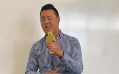 "English teacher Aaron Kwan performs Stevie Wonder's ""For Once In My Life"" before his class, bringing his passions for teaching and singing together."