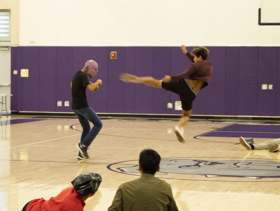 Junior Jason Chen and Sophomore Jun Kim stage a fake fight while rehearsing for the pep rally. ASB rehearsed for 2 weeks prior to the rally.