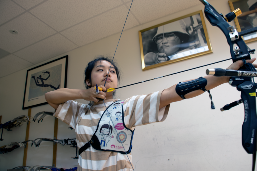 Choi anchors and prepares her shot while practicing for the Cotton Boll Classic, a state outdoor tournament that attracts over 400 archers every year.