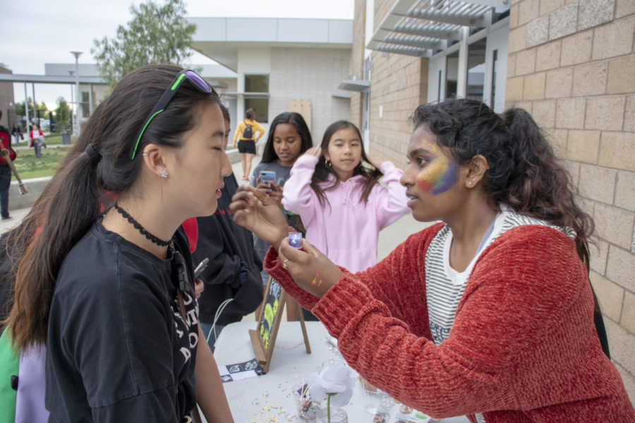 ASB member and junior Ananyashri Komarlu completes junior Arisha Liao's festival look with glitter and paint on each cheek.