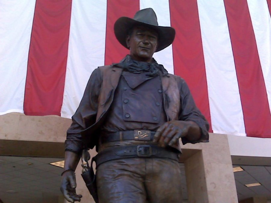 "A nine-foot bronze statue of John Wayne on a marble pedestal named ""The Duke"" stands tall within John Wayne Airport, overlooking the Thomas F. Riley Terminal. Commissioned by the John Wayne Associates, sculptor Robert Summers created the statue to honor John Wayne and his patriotism."