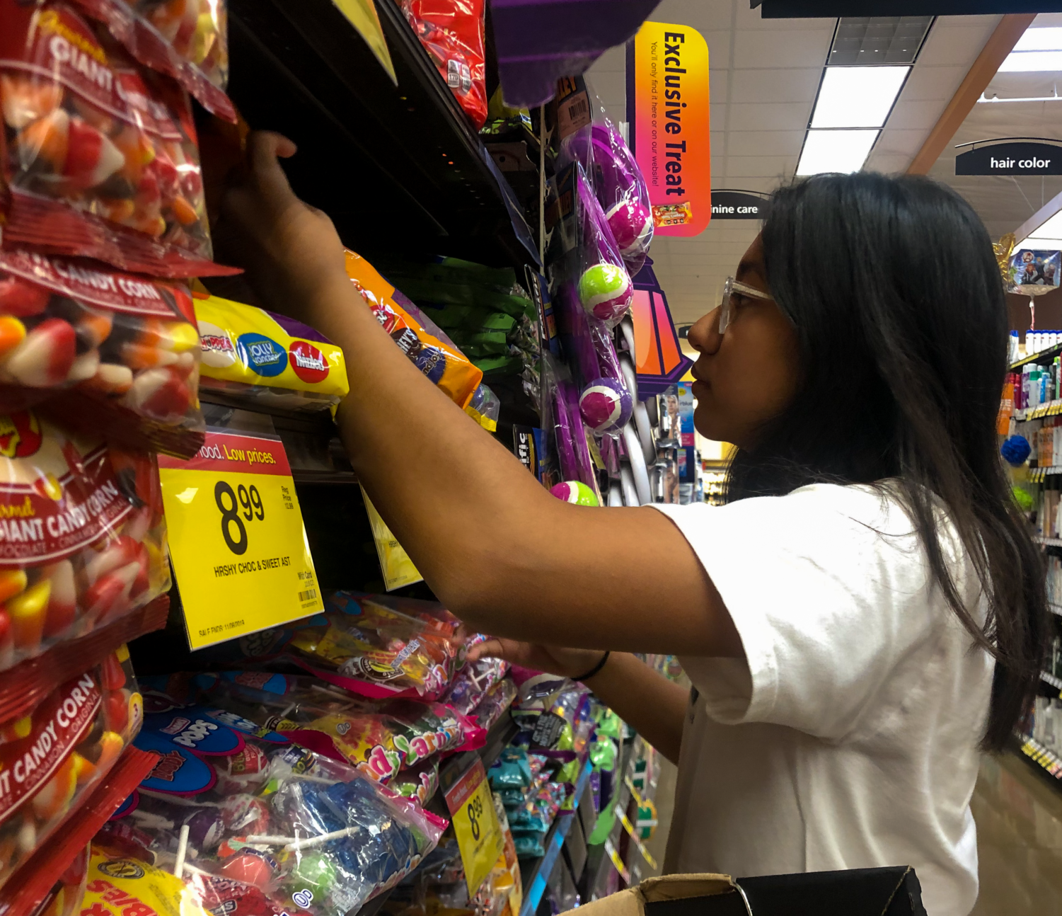 Sophomore Cinta Adhiningrat takes a look at the candy selections in the Halloween candy aisle at a local Ralphs. She mentions that her favorite candy is KitKats while her least favorite candy is Candy Corn.