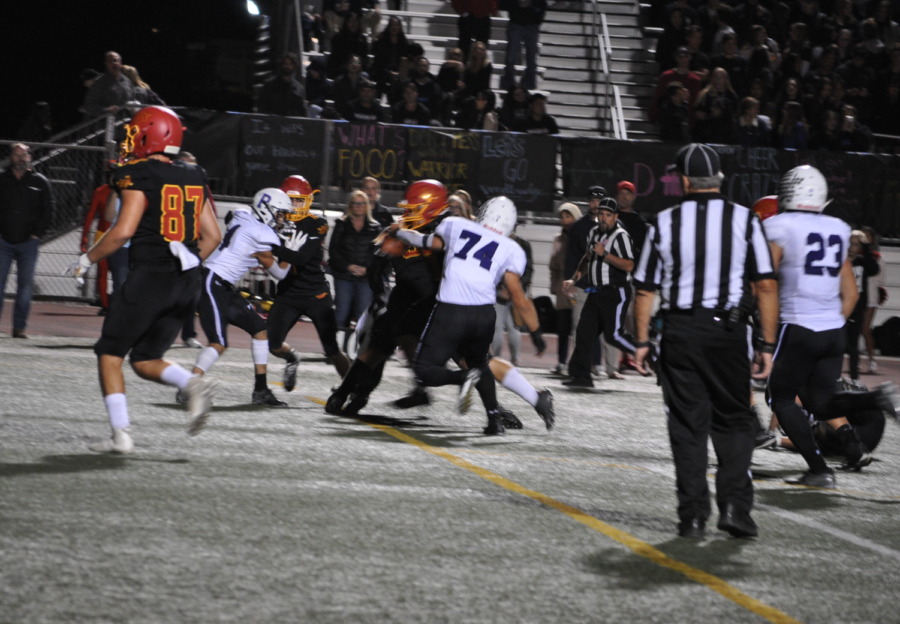 Team captain Adrian Valerin makes a tackle for the Bulldogs on third down. The Bulldogs were able to contain the Warriors for most of the first half of the game, with aggressive defense.