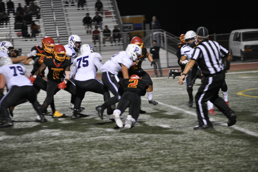 With Bulldogs in possession of the ball, the Warriors make a series of aggressive tackles in an attempt to regain possession. Although they scored two touchdowns in the third half, the game ended in a Bulldog victory 35-28.