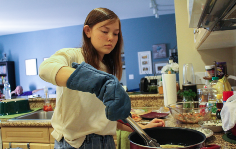 Junior Faith DeNeve prepares lumpia, a type of Filipino spring roll, from memory and shares her appreciation of the intimacy in home cooking as opposed to catering for large gatherings. The scratch-made variety yields a crisper exterior and the brightness of fresher ingredients.