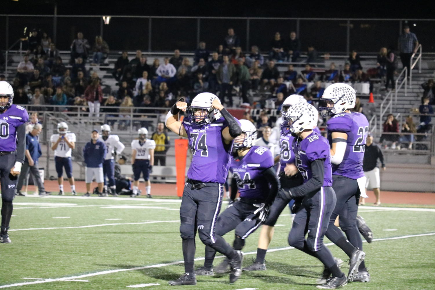 Valerin celebrates alongside his teammates after a big defensive play. The Bulldogs defense was able to contain Capistrano Valley Christian to just 19 points and hopes to continue this dominant play throughout the CIF run to help propel the team's dynamic offense to victory.