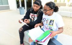 Amari Trevino-Beverly reviews systems of equations with her sister Ailani Beverly before her upcoming math test. Trevino-Beverly tutors her siblings in various subjects and disciplines.