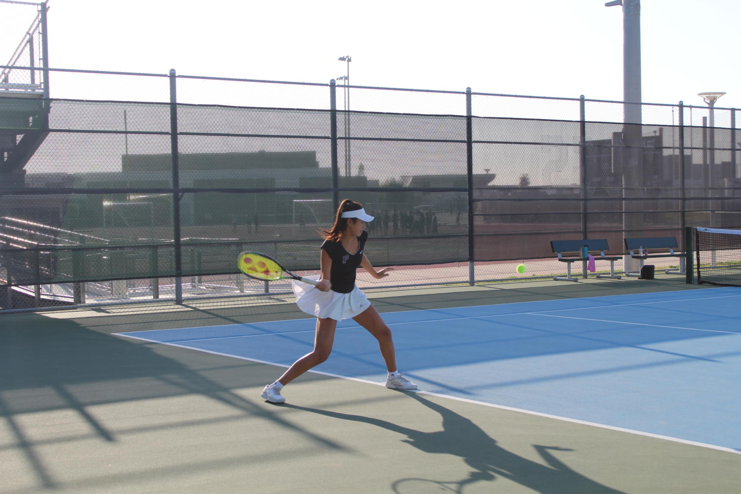 Freshman Anne Yang drives a forehand crosscourt after a short ball from her opponent. Yang went on to win the point and later win her match 6-0 against Trabuco Hills High's number two player.