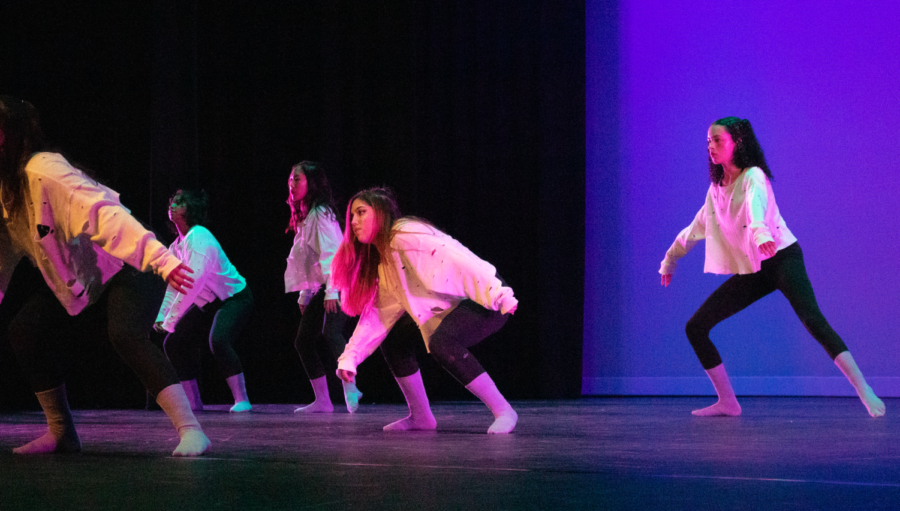 Dance+3+students+crouch+down+during+the+solo+section+of+the+piece%2C+%E2%80%9CCrybaby%2C%E2%80%9D+choreographed+by+sophomore+Mia+Zappala.+Choreographers+were+also+responsible+for+costume+design+and+stage+lighting%2C+fine-tuning+these+elements+to+enhance+their+overall+performance.+%0A