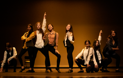 "As ""King of New York"" from popular musical ""Newsies"" drew to a close, freshman Sophia Albornoz, sophomore Esha Ananth, junior Vina Dinh, sophomore Amanda Zhu, junior Saba Firouzabadi, junior Sonia Goyle, junior Chloe Le, junior Shideh Moayed and sophomore Megan Suhr pose for the crowd. The song choice influenced the costuming and prop choices."