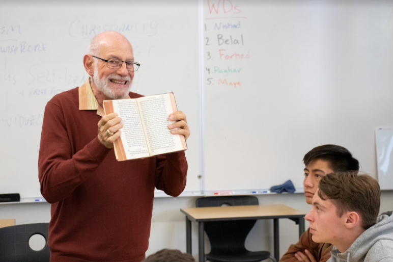Showing his copy of the Torah written in Hebrew, Rabbi Stephen Einstein helps students understand how translation of scripture from one language to another alters interpretations of religious ideas throughout history. Continuing the series, three more guest speakers will visit to talk about their respective religions: a speaker on Buddhism on Dec. 3, Mormonism on Dec. 5 and Islam on Dec. 17.