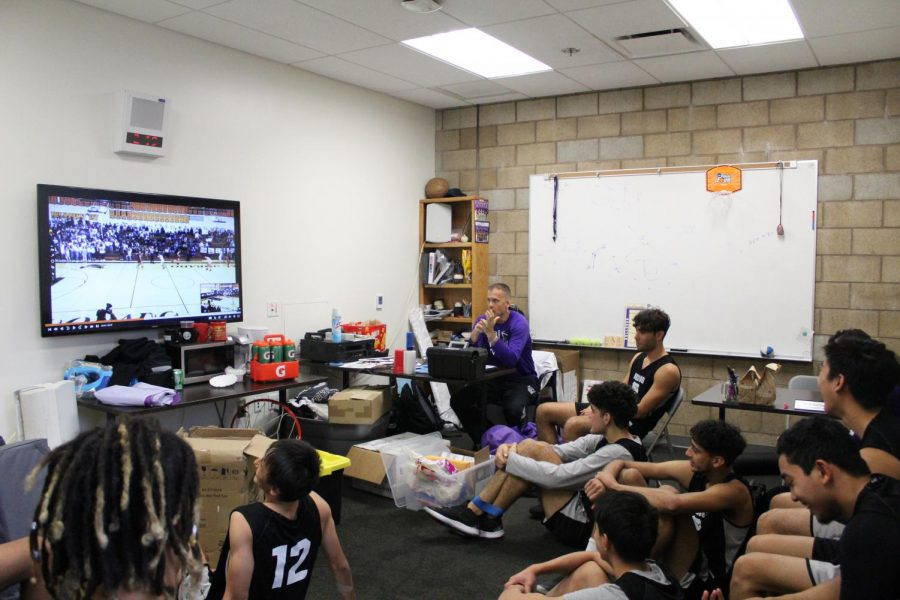 Boys' basketball analyzes video footage of their previous game, discussing points of transition, free throw percentages and further breakdowns of each play. This is a regular process to not only set goals but also create a specific action plan approaching the next game.