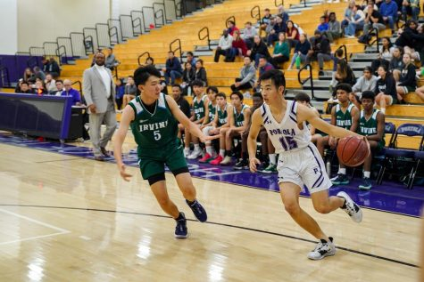 Forward and senior Justin Tam beats his defender off the dribble along the baseline.