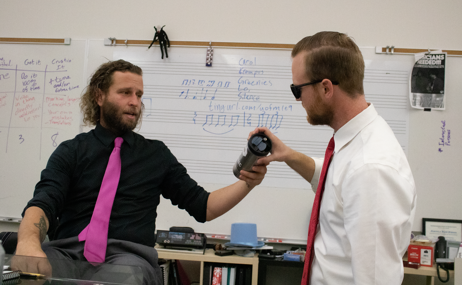 During break, students can often find music directors Desmond Stevens and Kyle Traska conversing in the music room about topics ranging from instrumental compositions to the many ways that one can decorate a water bottle.