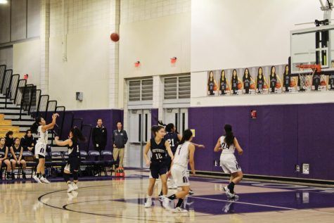 Shooting guard and junior Allyson Tabayoyong shoots a three-pointer in the second quarter of the game while being closely guarded by Northwood High captain and senior Amanda Endres. Overall, Tabayoyong scored 24 points for the team (55-43).