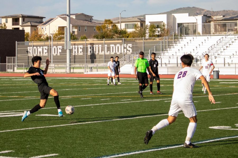 Senior Mustafa Hassan plays the ball forward in the midfield to start up the attack. The Bulldog midfield was crucial in helping control the game and dominate the Beckman side in possession.