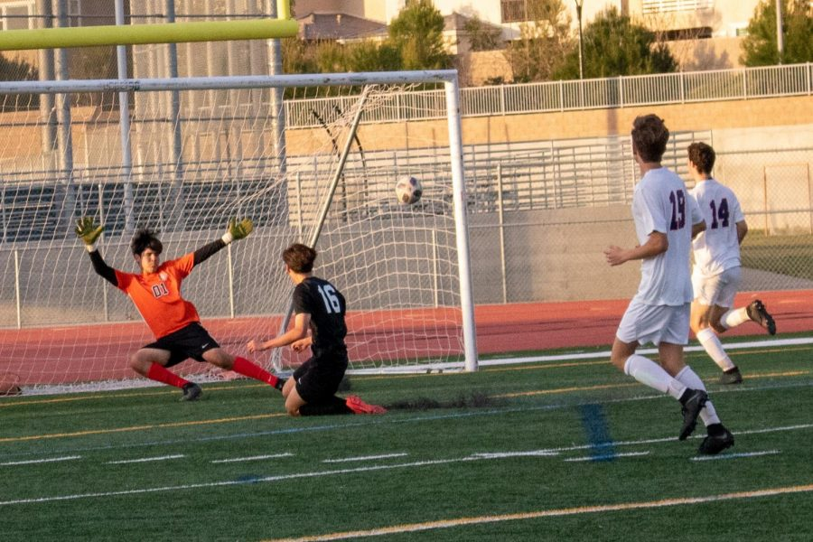 """Junior Sikyeong """"S.K."""" Kim scores the third and final goal of the game, beating the goalie with a powerful shot into the top right corner with his left foot. The goal was set up by junior Sherwin Salehi who outpaced the defense and sent a cross in."""