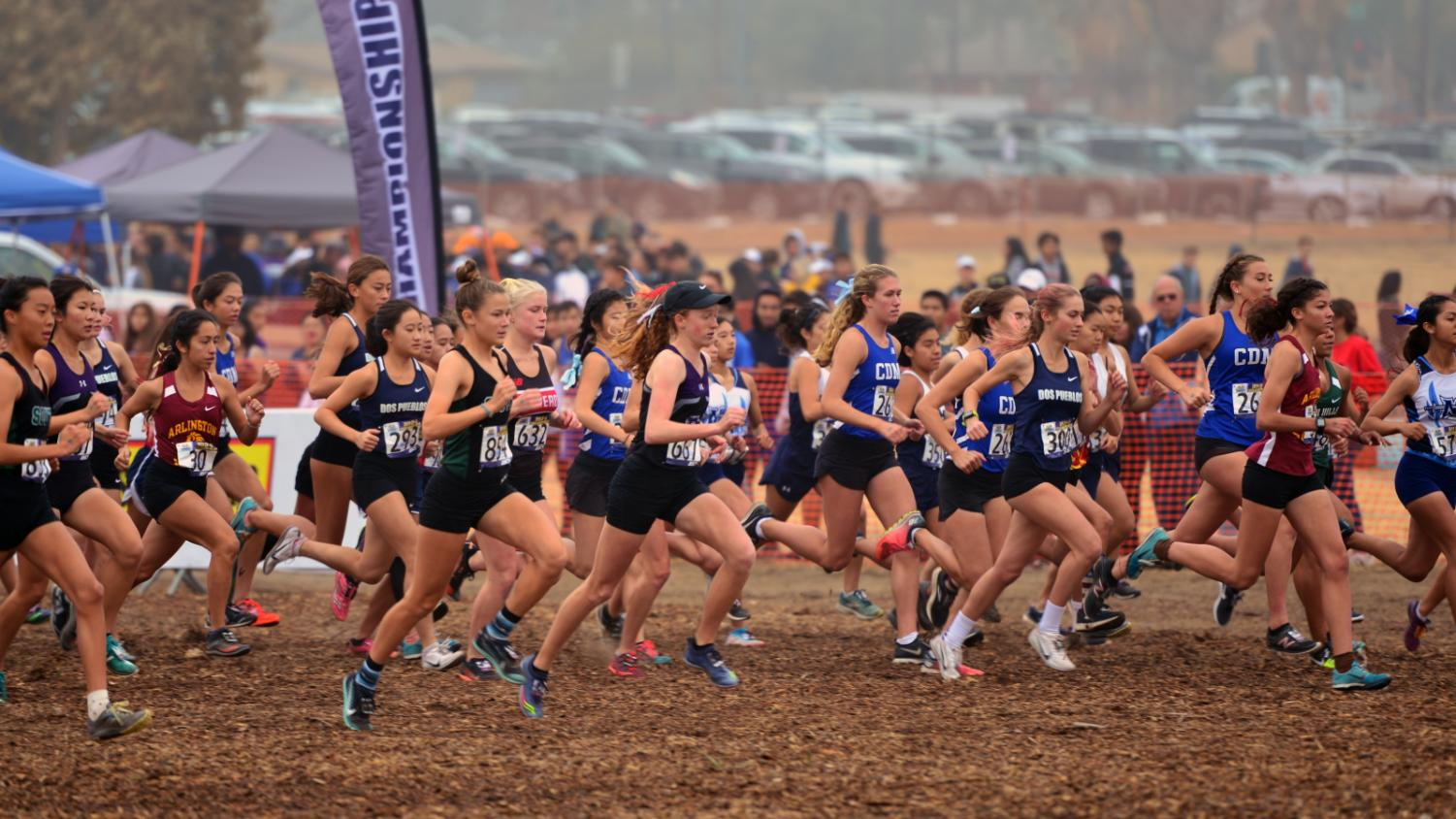Freshmen Jadyn Zdanavage explodes out of the startline at the CIF Southern Section Prelims meet. The girls cross country team has had many exceptional performances, including two first and one second place finishes at large invitationals.