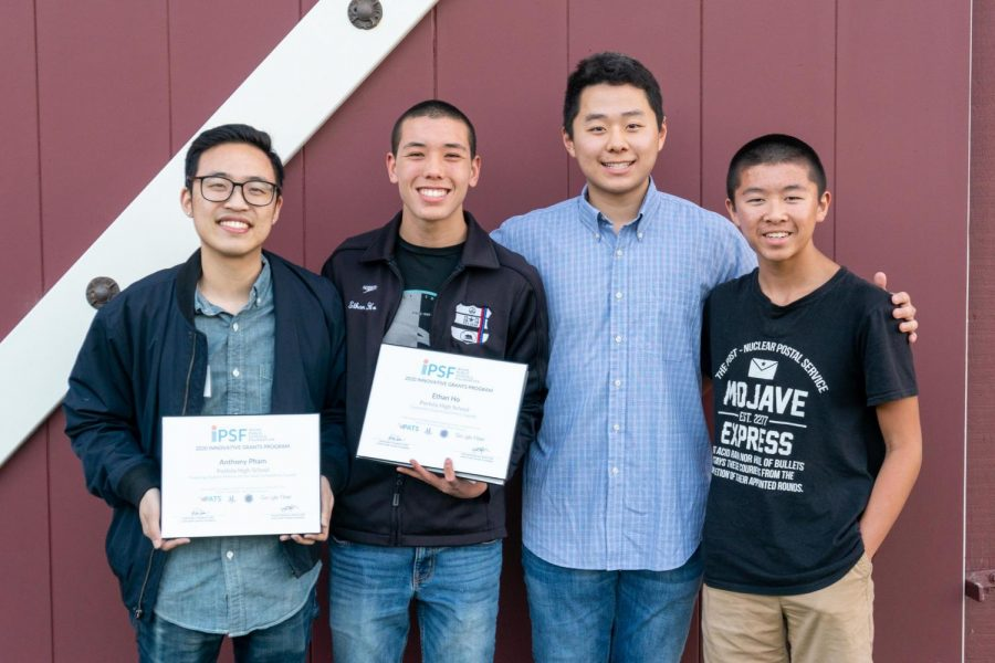 Teacher+Anthony+Pham%2C+senior+Benjamin+Kim+and+junior+Ethan+Ho+show+the+award+for+%E2%80%9CPreparing+Student-Athletes+for+the+Next+Competition%3A+Esports.%E2%80%9D%0A