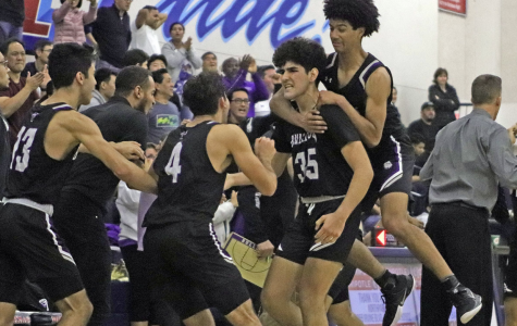 Boys basketball celebrates its league win after senior Mohsen Hasheimi shoots a game-winning shot in the last second of the game. The teammates celebrate their comeback after losing to Beckman 49-60 earlier in the season.