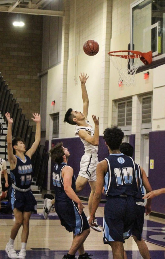 After providing strong defense for the backcourt, Senior Justin Tam steals the ball from University High and rushes to the frontcourt for a swift layup.