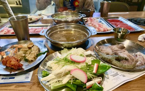 A plethora of different vegetables, meats, mushrooms and sauces surrounds two pots of simmering broth at All That Shabu. The restaurant provides a hotpot and a stove for each customer, who can then select cooked and raw foods from a buffet-style food bar.