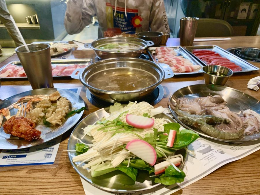 A+plethora+of+different+vegetables%2C+meats%2C+mushrooms+and+sauces+surrounds+two+pots+of+simmering+broth+at+All+That+Shabu.+The+restaurant+provides+a+hotpot+and+a+stove+for+each+customer%2C+who+can+then+select+cooked+and+raw+foods+from+a+buffet-style+food+bar.