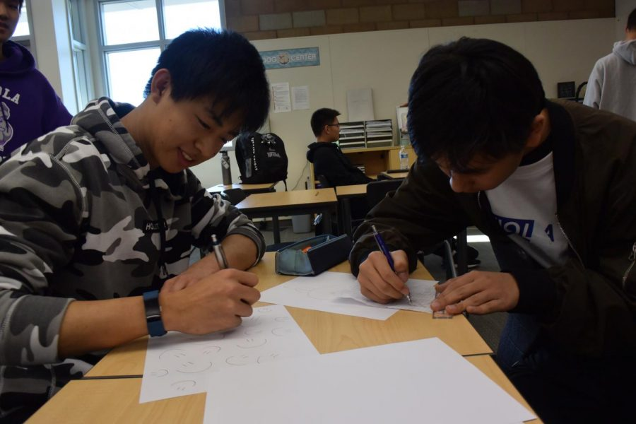 Seniors+Leonard+Yu+and+Ryan+Shih+work+out+a+practice+problem+together+on+the+day+of+the+AMC+exam.