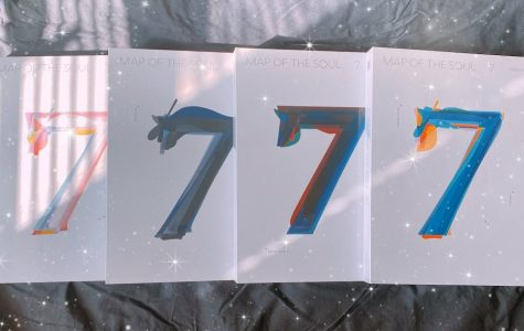 "BTS's ""Map of the Soul: 7"" features four versions, all with different colored covers, including shades of pink and white, blue and black, blue and red, and blue and orange. The number ""7"" symbolizes the seven members of the group as well as the number of years they have been together."