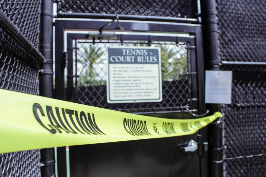 A local tennis court in Portola Springs is blocked with caution tape. The stay-at-home order left the usually packed courts vacant on a Saturday afternoon.