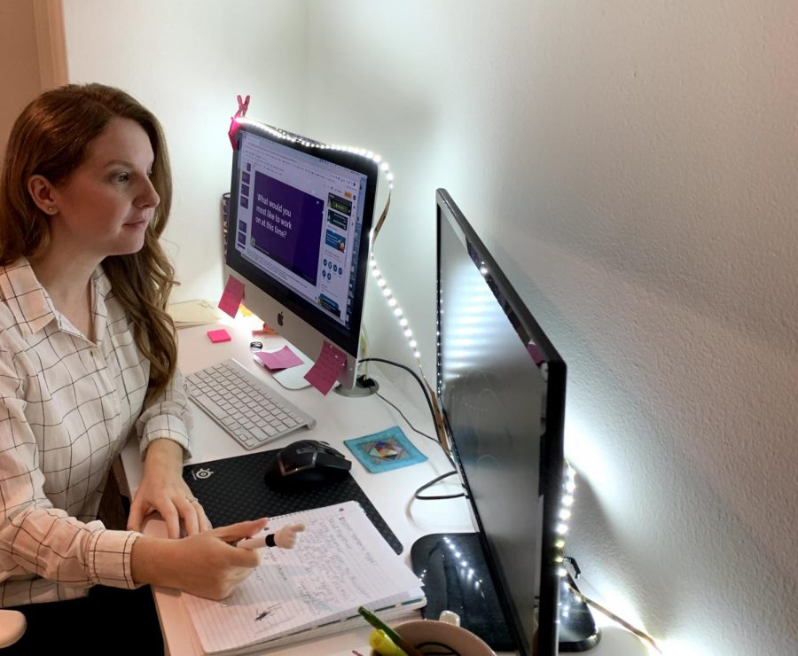"""Like most others who teach via IVA, English teacher Madeline Greenwood works from home. """"I have a hallway where I have a desk setup. I have a pretty nice setup — I have two monitors,"""" Greenwood said. Greenwood's husband who teaches math also chose IVA for the same health reasons and works alongside Greenwood during the day."""