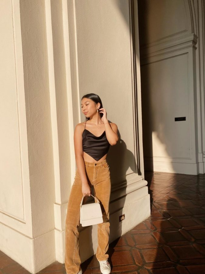 Corduroy pants: Junior Natalie Ho sports a thrifted pair of tan corduroy pants. Popularized in the 1970s for their distinct, vertical ribbing, corduroy pants are a soft and comfy piece perfect for the fall season.