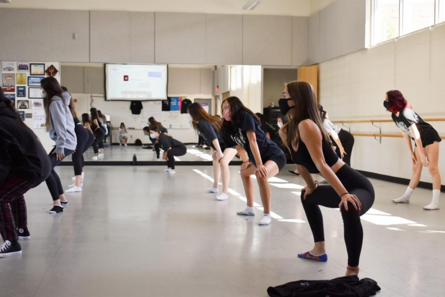 Before reviewing what they learned the previous class, dancers quickly perform a stretch routine along to one or two songs.