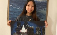 """I tend to fill the paper a lot. Instead of just focusing on one main part, I like adding a lot of details and filling up the composition,"""" senior Grace Hong said."""
