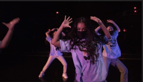 Senior Sonia Goyal and junior Amy Chen perform their socially-distanced number called Bola Rebola. All of Dance Company performed the same dance for the video pep rally, but in small groups of five to seven people.