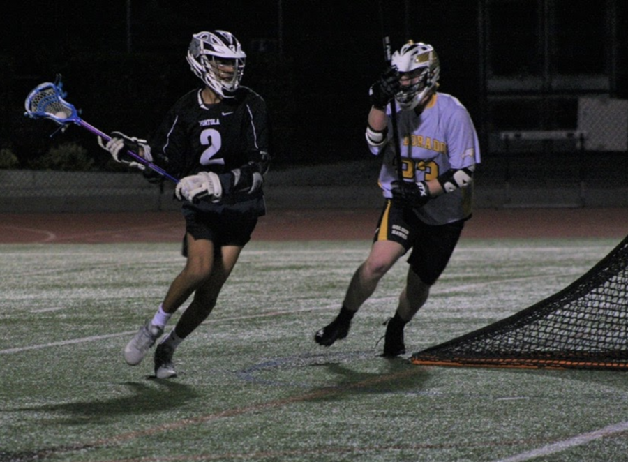 Junior, Khalil Dhanidina, has played lacrosse for five years now and continues to practice during the pandemic through off-season training at school which includes socially distanced drills. Pictured is Dhanidina playing against an El Dorado High defender.