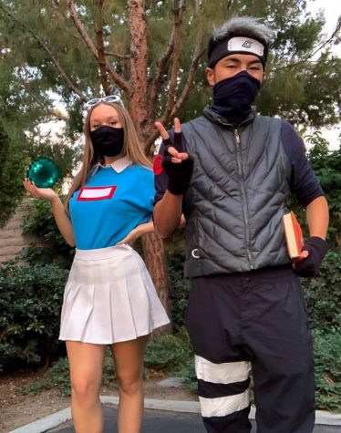 Junior Kate Brooks and senior Isaac Yang dressed up in creative costumes that also incorporated their masks to ensure they were both following CDC health guidelines.